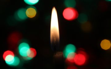 Photo of Christmas candles from David Sonluna from Unsplash